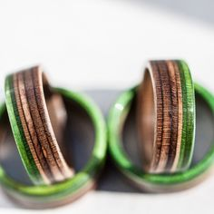 Handmade wooden wedding rings made from broken skateboards. As a skateboard, it contains 7 colorful layers of canadian maple, really hard wood. Every ring is 100% waterproof, so it never lost his shine, in direct contact with water and dirt too.