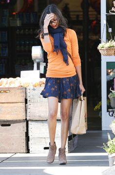Zoe Saldana Sweet Outfit : Girlie Blue Skirt with orange prints + Orange Sweater + Blue Scarf + Beige Booties