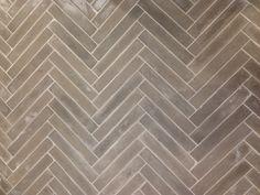 grey herringbone tile (photo of anthropologie floor)
