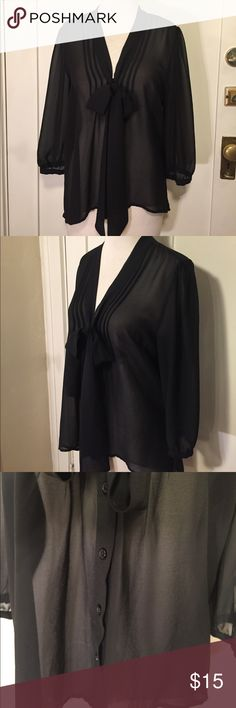 Pins & needles black chiffon tie neck black blouse This is a beautiful blouse from urban outfitters by pins and needles, Black semi sheer material, front pleats with neck tie and button down section, quarter sleeves with buttons. Fits more like a small. Good condition minor wear small snag at bottom. See pictures for details. Be sure and check out other items in closet and bundle to receive discounts. Urban Outfitters Tops Blouses