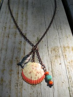 Coral paint-dipped scallop seashell charm necklace with carved pen shell minnow fish dangle