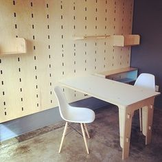 Kerf Wall modular storage system by Kerf Design. Shown in hardwood maple veneer plywood with a white laminate topped table, shelving, and open cubby components. kerfdesign.com kerfdesign's Instagram photo