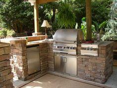 cuisne extérieure en pierre et barbecue encastré inox