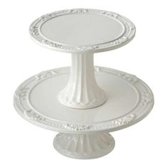 Love cake stands...probably like the glass ones better than these.  Makes any cake look better.