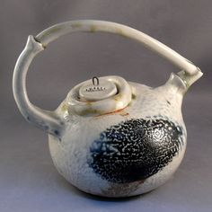 Fired in a soda and wood kiln