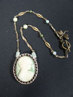 "Summer necklace: Here is a closer image of the full necklace, ""Green and White Cameo"" with the brasstone old pieces and milky glass lite green beads. www.marshasavage.com"