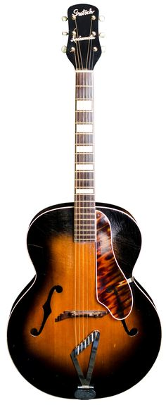 """Gretsch 1952 Synchromatic 100/6014 This beautiful acoustic archtop was made by Gretsch in 1952 with the """"Synchromatic"""" model script displayed on the headstock. This model is widely known as both the """"100"""" and also """"6014"""".In a gorgeous old school sunburst finish, this guitar oozes style with the stair-step bridge, a harp tailpiece,..."""