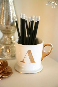 @Anthropologie Gold and White Monogram mug..used for pencils