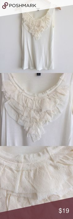 """Ann Taylor Ivory Tencel Silk Ruffle Front Tank S Beautiful tank top from Ann Taylor features a finely ribbed Tencel body and tiers of silk ruffles at neckline. Great for layering!  • size M • 27"""" length from shoulder  • color: ivory • 100% tencel exclusive of trim • gently worn a few times and in good condition, minor signs of wear Ann Taylor Tops"""