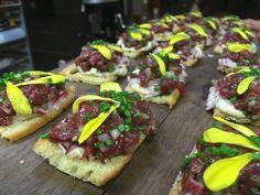 Bison Tartare, Whole Grain Mustard & Brandied Cherry Aioli, Pickled Radish & Moutain Flowers