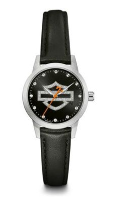 <div> A simple statement of Harley® elegance. This black analog watch from the Glittler Collection features an over-sized sparkling Bar & Shield® silhouette as the center focus, with crystal markers at the hour positions. The orange second hand with the signature H-D® counterweight accents the precision timing. Stainless steel case. Black calf leather%2...