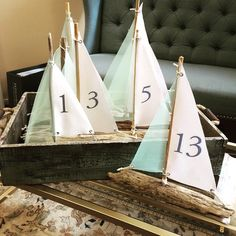 Our driftwood sailboat table numbers can be customized to match your wedding colors! These are going to be just the right touch for Megan's mint and navy nautical wedding this weekend! #2handsstudios #nauticalwedding #annapoliswedding #rentaldecor #weddingdecor #driftwoodsailboat #mintandnavy #tablenumber