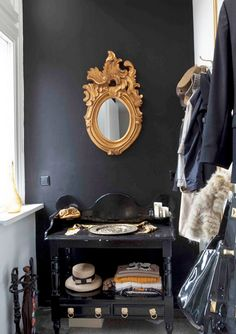 black wall + gold accent