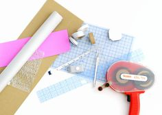 Materials you'll need for corrugated paper book wrap:  corrugated paper, washi tape, paper scraps