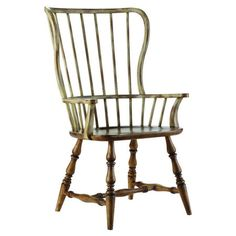 Distressed hardwood arm chair with spindle back and turned legs.      Product: Arm chair    Construction Material: Har...