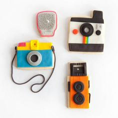 Camera Cookies... a polaroid, a TLR, and a toy camera... ahhh.. the good old days of film. This is real legit though.