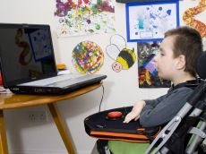 Trabasack:  Trabasack switch mount and play tray.  Award winning low-cost buggy tray and bag that has a 'velcro' ready surface for switches and toys. Attaches to any therapy chair or wheelchair with supplied straps or rests on lap. Light weight and easy to carry.