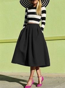 Black Midi Skirt Flare Pleated Trendy Long Skirt. This is the perfect oversized flare skirt to wear out to any event. Pair it with a tight long sleeve shirt for