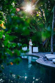 The lake-like pool of UXUA Casa Hotel & Spa and a bride almost ready to walk the aisle. #Trancoso #Wedding