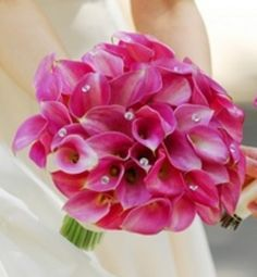 Love this!! Royal Beauty - wedding bouquet  Hot pink calla lilies in a hand-tied bouquet. An amazingly beautiful hand-tied bouquet with 30 hot pink calla lilies with crystal detail in the center of some blooms.