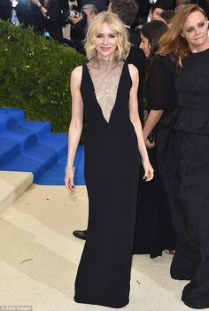 Cha-chain! Naomi Watts stuns in plunging Stella McCartney black gown with shimmering netti...