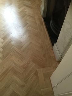 Client: Private Residence In North London  Brief: To supply & install herringbone wood flooring to living area