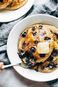 Best pancakes Ive ever made! Super basic, thick and fluffy blueberry pancakes - melt in your mouth, golden brown, and bursting with blueberries. #pancakes #blueberrypancakes | pinchofyum.com