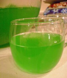 Trish Yearwood's Green Punch .. refreshing drink made with lemon-lime Kool-Aid, pineapple juice, frozen lemonade concentrate, ginger ale & sugar