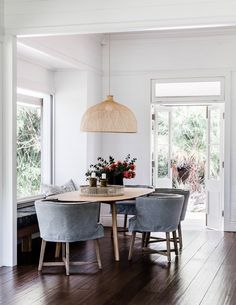 A Modern Bungalow Dining Room with Curved Seating + Rattan Pendant Light via Louise Walsh // Modern Dining Room Design Ideas Dining Nook, Dining Room Design, Kitchen Dining, Nook Table, Kitchen Nook, Dining Room With Bench, Cute Kitchen, Kitchen Shelves, Dining Room Table Centerpieces