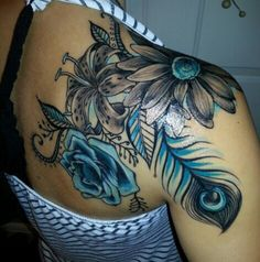 Love the blue in this tattoo!/ shoulder tattoos ideas/ flower tattoos/ tattoos designs