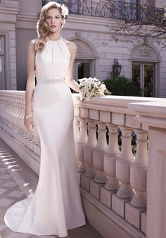 White satin sheath gown with halter neckline | Casablanca Bridal | https://www.theknot.com/fashion/2128-casablanca-bridal-wedding-dress