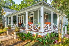 i love the house color and porch. different accent color for furniture but i like the overall effect
