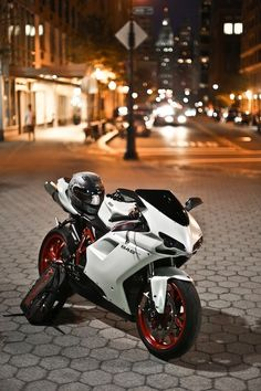 Ducati! If I ever owned a bike I would love to own a ducati! White with black & have maybe blue rims... not sure but I would love this!