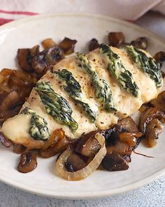 Goat cheese & spinach stuffed chicken breast make an amazing low carb and keto-friendly dinner! These baked chicken breasts are easily cut 'hasselback style' then stuffed with creamy cheese… Baked Stuffed Chicken, Goat Cheese Stuffed Chicken, Baked Chicken Breast, Chicken And Goat Cheese Recipe, Stuffed Chicken Breasts, Caramelized Onions And Mushrooms, Spinach Stuffed Mushrooms, Spinach And Mushroom, Baked Chicken And Mushrooms