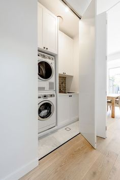 The owners of this neat 3 bedroom semi in Petersham approached us with a simple and common brief - fix the badly planned rear addition. Working within the existing footprint the scheme remodeled a. Laundry Cupboard, Utility Cupboard, Laundry Nook, Laundry Closet, Laundry Room Organization, Laundry In Bathroom, Hidden Laundry Rooms, Modern Laundry Rooms, Küchen Design