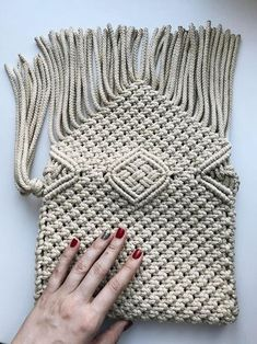Stunning macrame bag is suitable for your bright summer fashion style. On light walks you should not wear heavy bags and carry a lot of things with you. All you need is a smartphone, a purse, lip gloss and all this things fits easily into your bag. A bright color of the macrame will make
