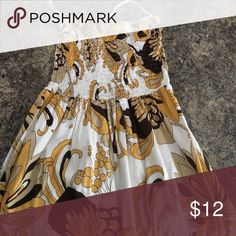 Mid Length Dress A strapless mid length dress with a brown and yellow print, perfect for summer! Lightly lined in skirt. Dresses Maxi