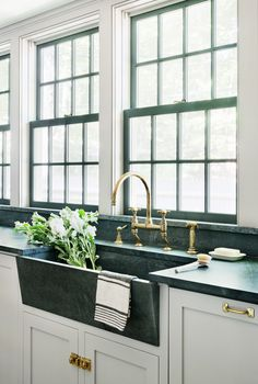 modern green marble apron sink with classic brass hardware and gorgeous kitchen windows | coco kelley