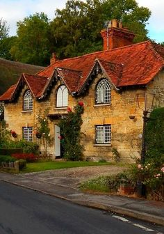Erlestoke, Wiltshire, England THIS is the kind of house I LOVE.add green shutters, flowered window boxes and wall-climbing roses and it's my dream cottage.just needs more front garden room. Cozy Cottage, Cottage Homes, Cottage Style, Cottage Door, Cottage Exterior, Beautiful Buildings, Beautiful Homes, Beautiful Places, English Country Cottages