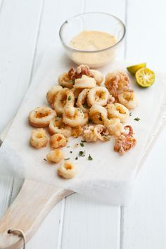 As much as I am trying to make healthier foods, how can I pass on calamari?!  Yum.