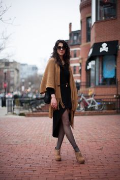 Self Described Style: Boho ChicFavorite Store in Boston: LFOccupation: Photography StudentSpotted at: Newbury St.  Black and tan look great together and her outfit certainly proves it! She has chosen pieces of different lengths and textures which create a lot of visual interest. I am usually not the biggest fan of fringe but there is something about the way she wears it that feels very elegant and current.
