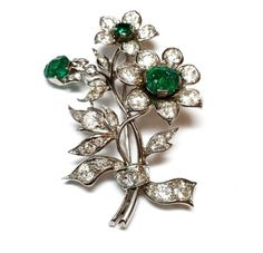 Emerald Diamond Flower Brooch. Flower brooch in gold and platinum, filled by 45 old european cut diamonds (5.50ct total weight approx.) and 3 octogonal emeralds (2.35ct total weight approx.) Circa 1950
