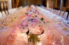 I love how this table is decorated with peonies.