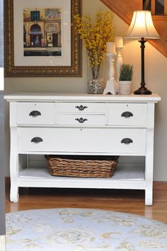 Paint a dresser; take out bottom drawer, add baskets and there is an awesome accent table! Entry way