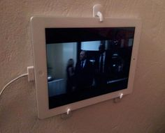 If you want to watch Netflix in bed or while washing dishes, use a few Command hooks for a cheap and easy display.