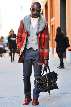 Red Plaid Coat with Faux Fur Collar, Leather Man Bag, Gray Vest, & Navy Chinos.. Men's Fall Winter Street Style Fashion.
