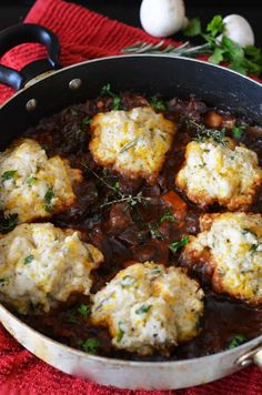 Guinness Beef Stew with Cheddar Herb Biscuits. Whether you're Irish or not, you'll love this stew for St. Patrick's day (and any cold night when you could use a hearty dinner)! | blog.hostthetoast.com