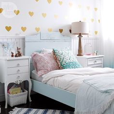 """Looking for an easy and cost-effective alternative to wallpaper for a kid's room? Why not try wall decals! Check out this and other great tips for decorating a kid-friendly room, search """"decorating kids' rooms"""" on styleathome.com! {Photo: Robin Stubbert 