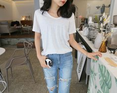 Stock your closet with basic but chic items like this everyday wear heathered t-shirt from Daily About.