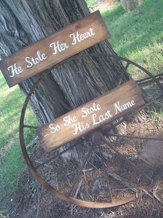 Stained Rustic Wooden Wedding Signs / http://www.deerpearlflowers.com/rustic-country-wagon-wheel-wedding-ideas/2/